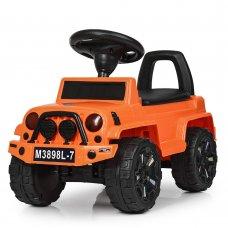 Толокар детский с кожаным сиденьем M 3898L-7 оранжевый